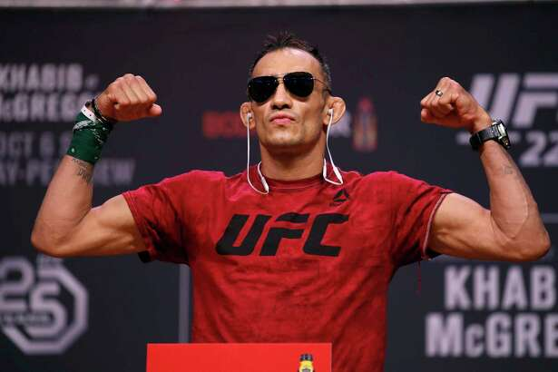 FILE - In this Oct. 5, 2018, file photo, Tony Ferguson poses during a ceremonial weigh-in for a UFC 229 mixed martial arts fight in Las Vegas. UFC 249 scheduled for May 9, 2020, at Jacksonville Arena will be headlined by lightweight title contenders Tony Ferguson and Justin Gaethje. (AP Photo/John Locher, File)