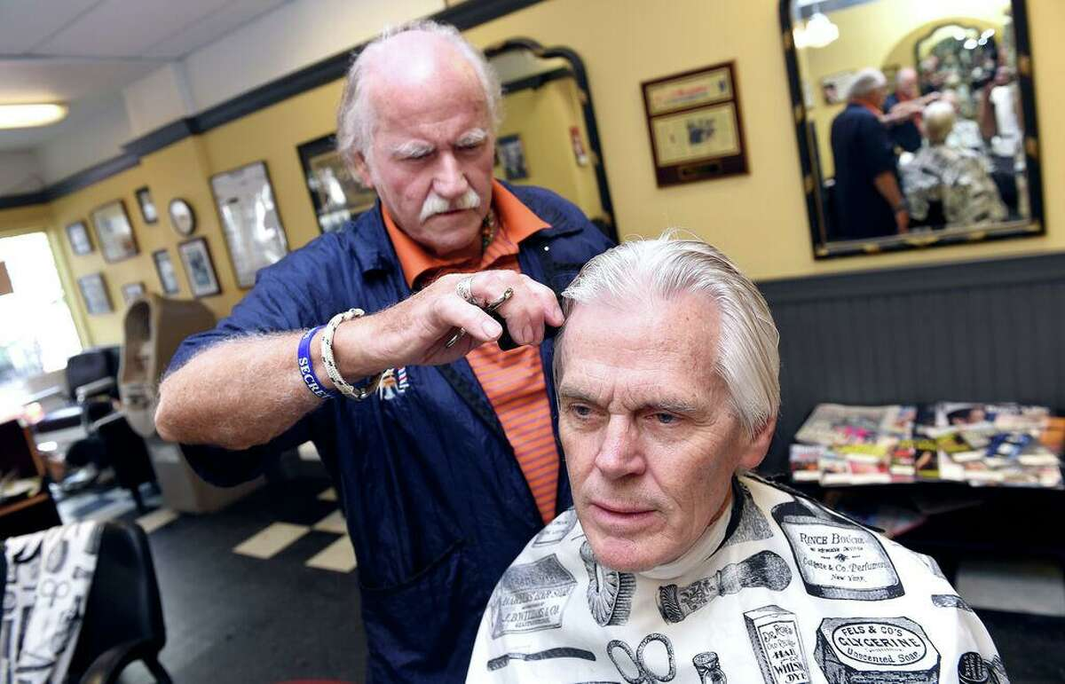 New Haven Register columnist Randall Beach gets a haircut from Carl McManus at Phil's Hairstyles in New Haven on August 28, 2018.