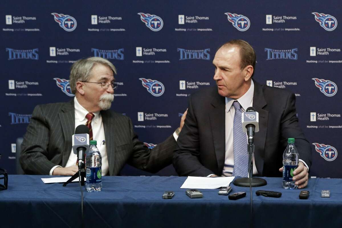 Tennessee Titans president and CEO Steve Underwood, left, talks with recently hired head coach Mike Mularkey at a news conference Monday, Jan. 18, 2016, in Nashville, Tenn. Mularkey was previously the team's interim head coach. (AP Photo/Mark Humphrey)