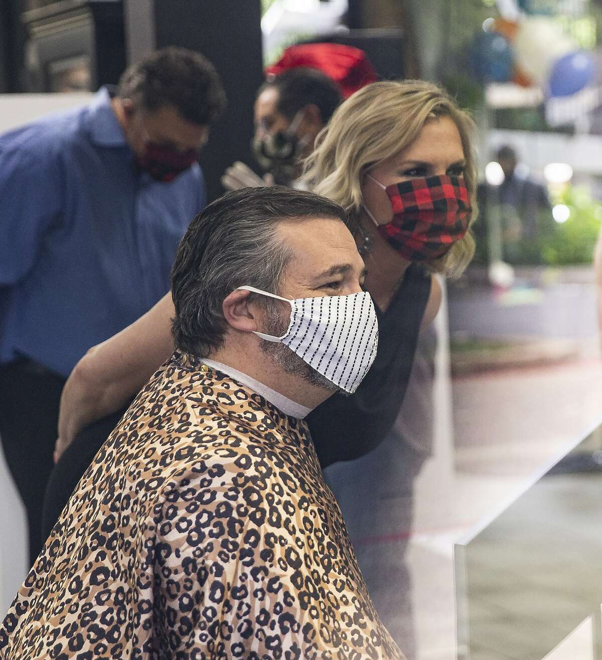 U.S. Sen. Ted Cruz chats with owner Shelley Luther before getting a haircut at Salon a la Mode on May 8, 2020 in Dallas. (Juan Figueroa/ The Dallas Morning News/TNS)
