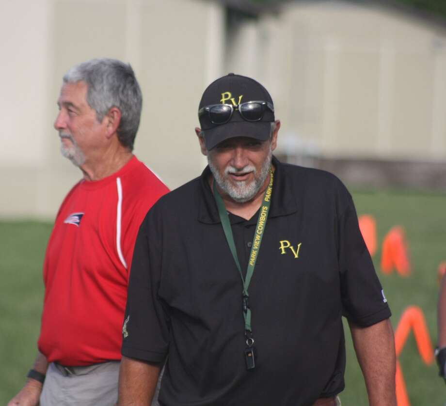 Park View football coach Elton Blanchard and former Bondy Intermediate coach Russell Hancock made each other smile during a quick conversation along the sidelines one year. Photo: Robert Avery