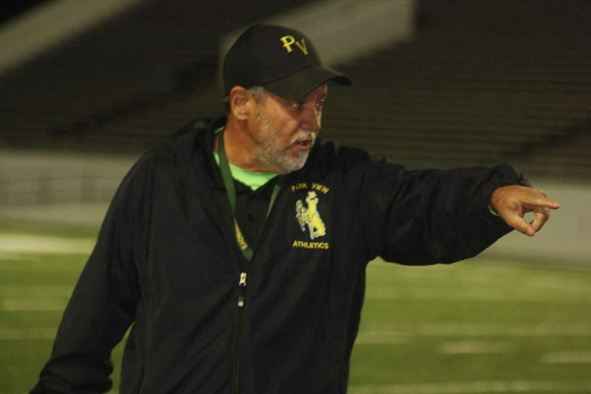 Elton Blanchard directs things from the sidelines during a football game at Veterans Memorial Stadium.