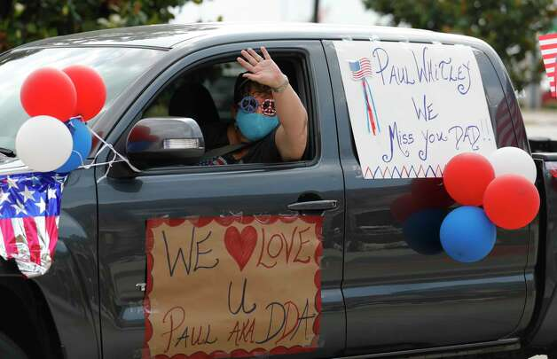 A woman waves to residents during a parade at Spring Creek Village Assisted Living & Memory Care, Friday, May 8, 2020, in Spring. Photo: Jason Fochtman, Staff Photographer / 2020 © Houston Chronicle