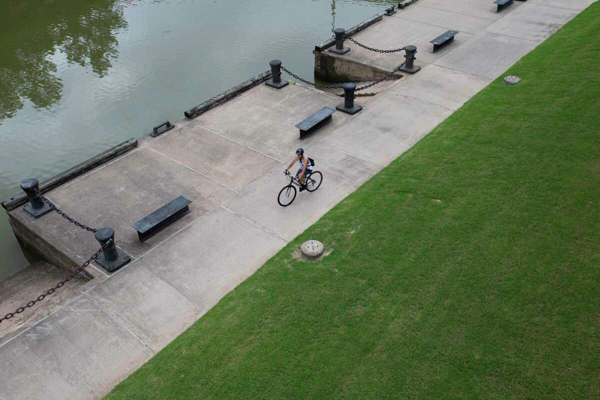 A bicyclist pedals along Buffalo Bayou on April 28, 2020, in downtown Houston.