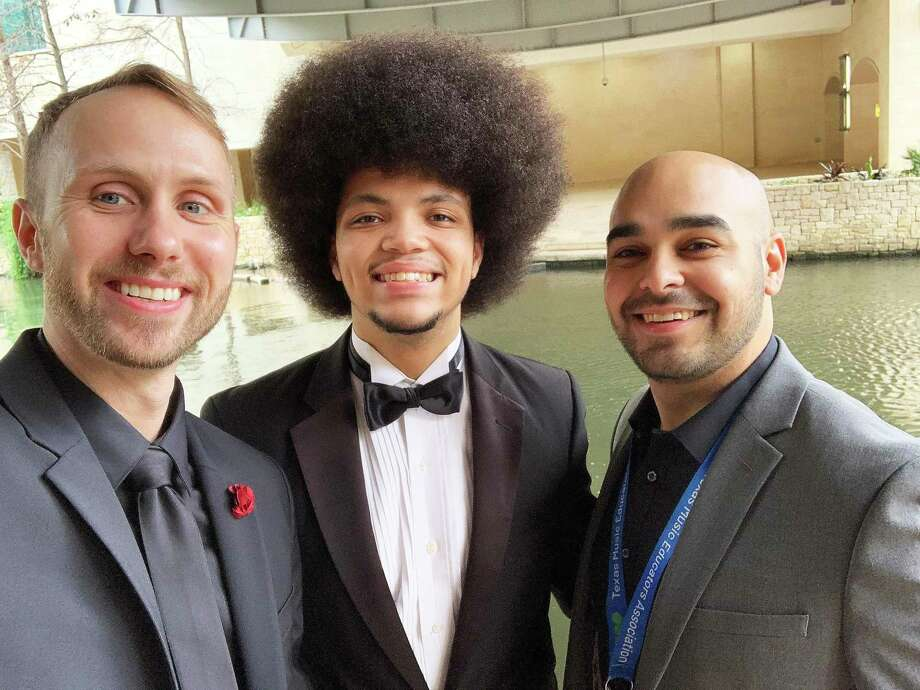 Crosby High School band director Kevin Knight (left) and associate director Michael Gonzales celebrate with their student Demetrius Sheats after he placed First Chair trumpet in the Texas All-State band. Photo: Submitted