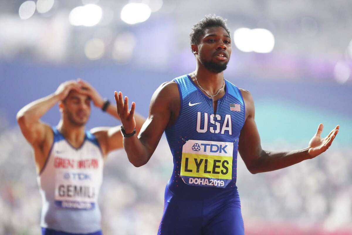 DOHA, QATAR - OCTOBER 01: Noah Lyles of the United States celebrates winning the MenA centsa'tms 200 Metres final as Adam Gemili of Great Britain looks on during day five of 17th IAAF World Athletics Championships Doha 2019 at Khalifa International Stadium on October 01, 2019 in Doha, Qatar. (Photo by Michael Steele/Getty Images)