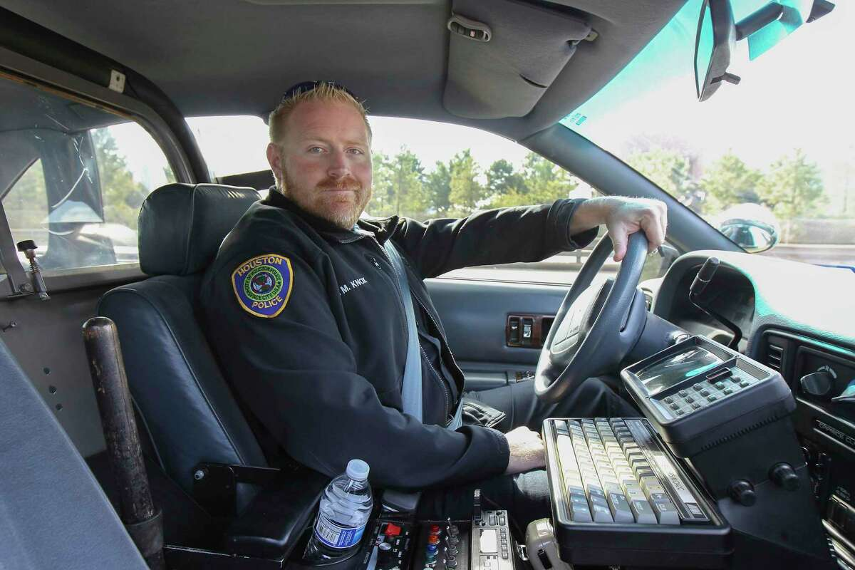 This Nov. 21, 2018, photo shows Houston police officer Jason Knox in a restored HPD cruiser in Houston. The Houston police department tweeted that Knox, a Tactical Flight Officer, was killed when a police helicopter crashed early Saturday, May 2, 2020, in Houston.