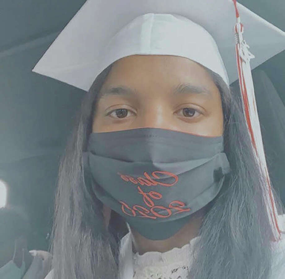 Graduating senior Serenity Anders shows her Class of 2020 face covering. Photo: Photo Provided