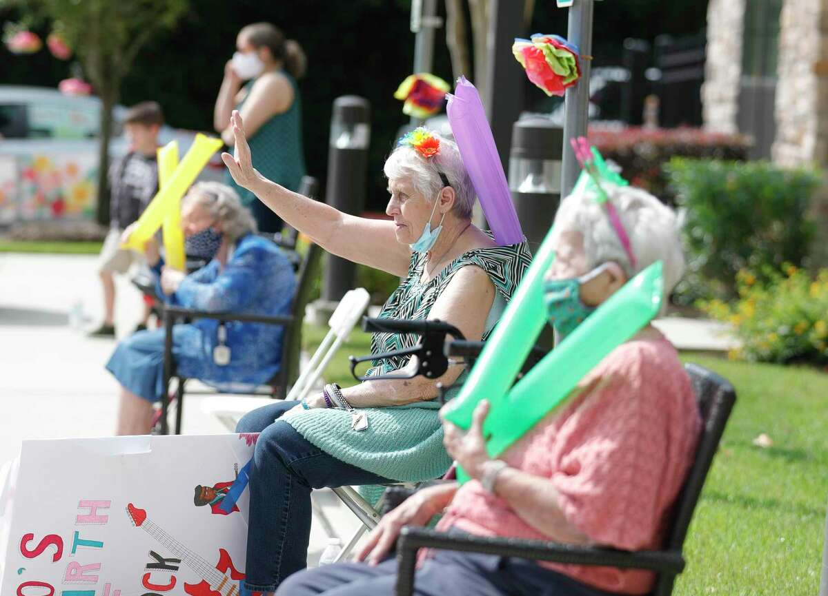 Residents take in a parade at Spring Creek Village Assisted Living & Memory Care, Friday, May 8, 2020, in Spring.