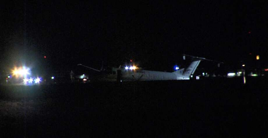 A small plane slid off the S.A. International Airport runway, while landing Friday night, airport police said. Photo: 21 Pro Video
