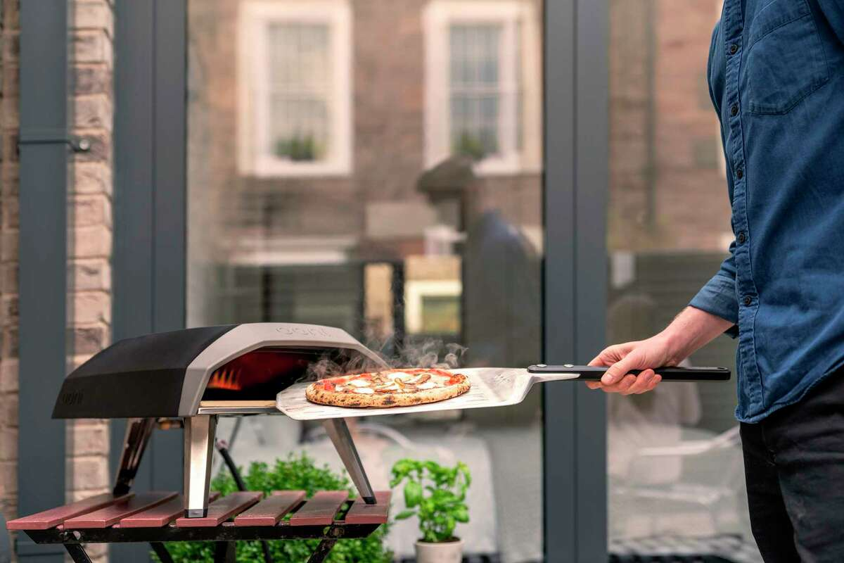 """This photo provided by Riverbend Home shows the handy Ooni Koda propane pizza grill, that's ready to go in 15 minutes and cooks pizza in about a minute a€?"""" as well as roasted fish, steak or vegetables. (Ooni Koda/Riverbend Home via AP)"""