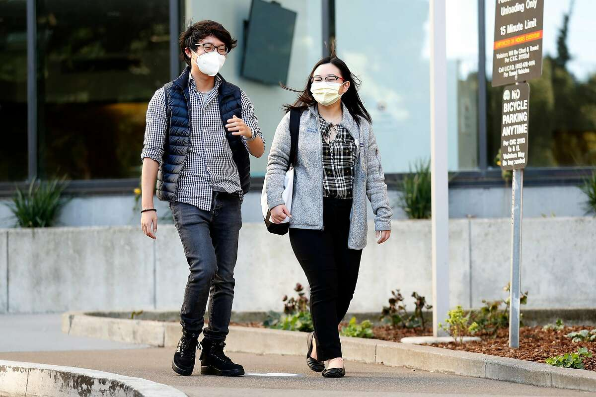 (left to right) Shawn Park and UCSF medical student Hallen Pham at UCSF Parnassus Campus in San Francisco, Calif., on Thursday, May 7, 2020. The couple have built a website that debunks myths about Covid-19.