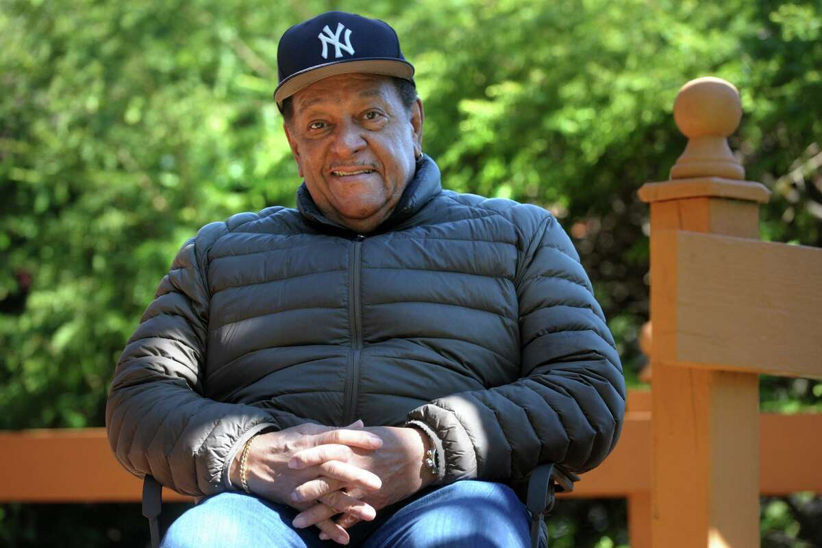 Rev. James Morton III of First Baptist Church, in Stratford, poses on the back porch of his Bridgeport, Conn. home May 6, 2020. Morton is recuperating at home after recently surviving COVID-19.