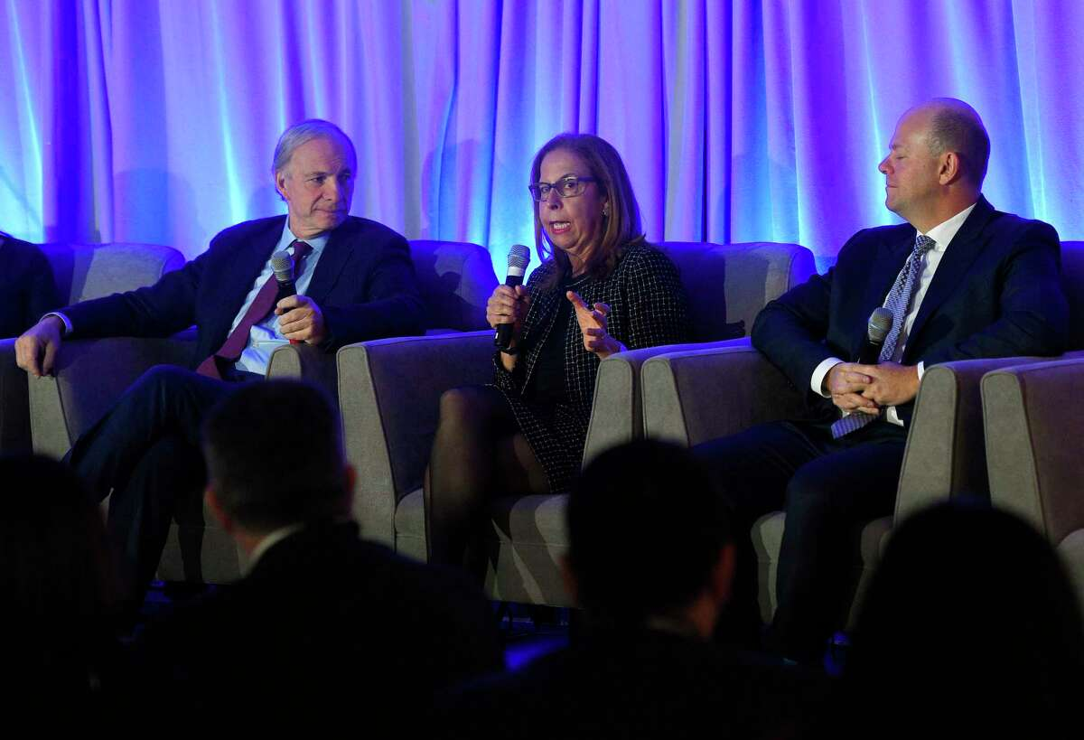 """RockCreek Founder and CEO Afsaneh Beschloss speaks beside Bridgewater Associates Founder Ray Dalio, left, and Balyasny Asset Management CEO and Managing Partner Dmitry Balyasny during day one of the Greenwich Economic Forum at the Delamar Greenwich Harbor in Greenwich, Conn. Thursday, Nov. 15, 2018. The two day event """"brings together 300+ of the world's leading minds in finance and public policy to discuss and debate the global risk environment."""" Greenwich billionaires Ray Dalio, of Bridgewater Associates, and Paul Tudor Jones, of Tudor Investment Corp., were featured speakers at the event."""