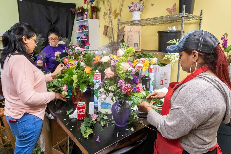 The ladies at Petals Florist finish up putting some Mothers Day bouquets together. From left are Alex Sosa, Sandra Hubbell and Mary Camargo. Since people are dealing with the separation from their mothers because of the pandemic, they have sold out of most of what they had and will be open on Sunday with more. Photo made on May 9, 2020. Fran Ruchalski/The Enterprise Photo: Fran Ruchalski/The Enterprise / ? 2020 The Beaumont Enterprise