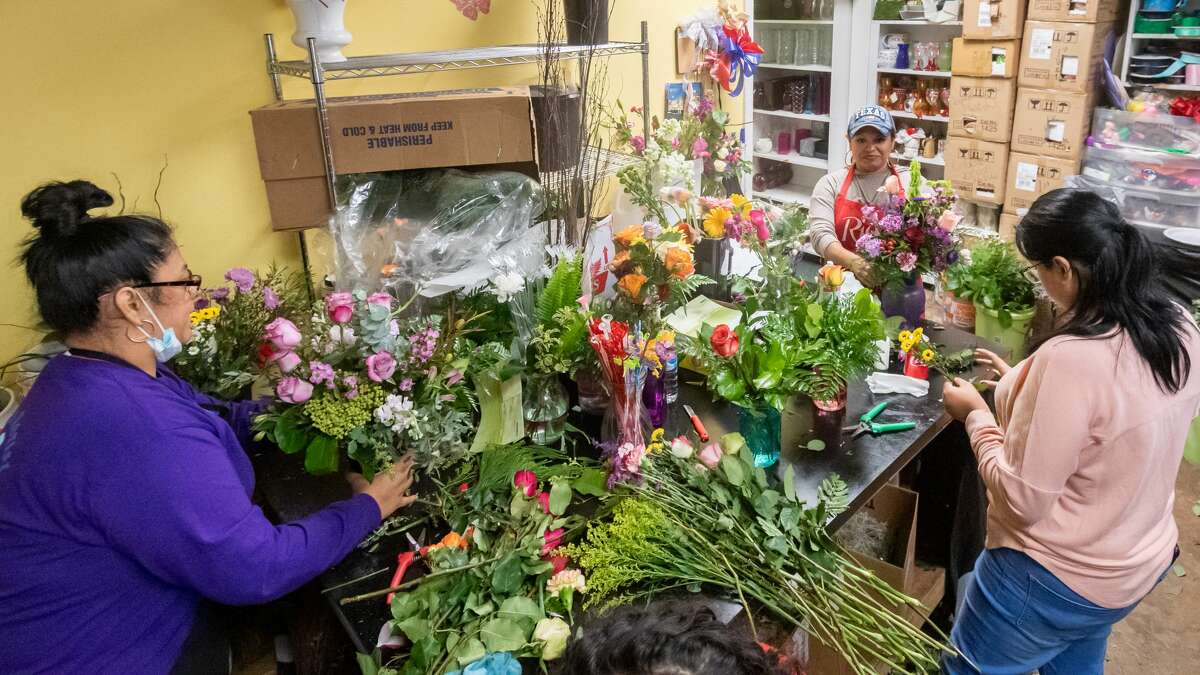 The ladies at Petals Florist finish putting some Mothers Day bouquets together. From left are Sandra Hubbell, Mary Camargo, and Alex Sosa. Since people are dealing with the separation from their mothers because of the pandemic, they have sold out of most of what they had and will be open on Sunday with more. Photo made on May 9, 2020. Fran Ruchalski/The Enterprise