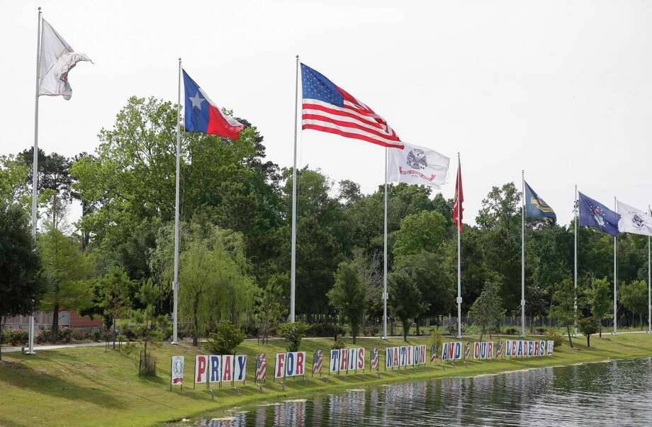 "A series of signs read ""Pray for this nation and our leaders"" at the Montgomery County Veterans Memorial Park, Saturday, May 9, 2020, in Conroe. Volunteers planted more than 1,000, red, white, and blue flags representing those who have died from COVID-19 from Texas so far. Photo: Jason Fochtman, Houston Chronicle / Staff Photographer / 2020 © Houston Chronicle"