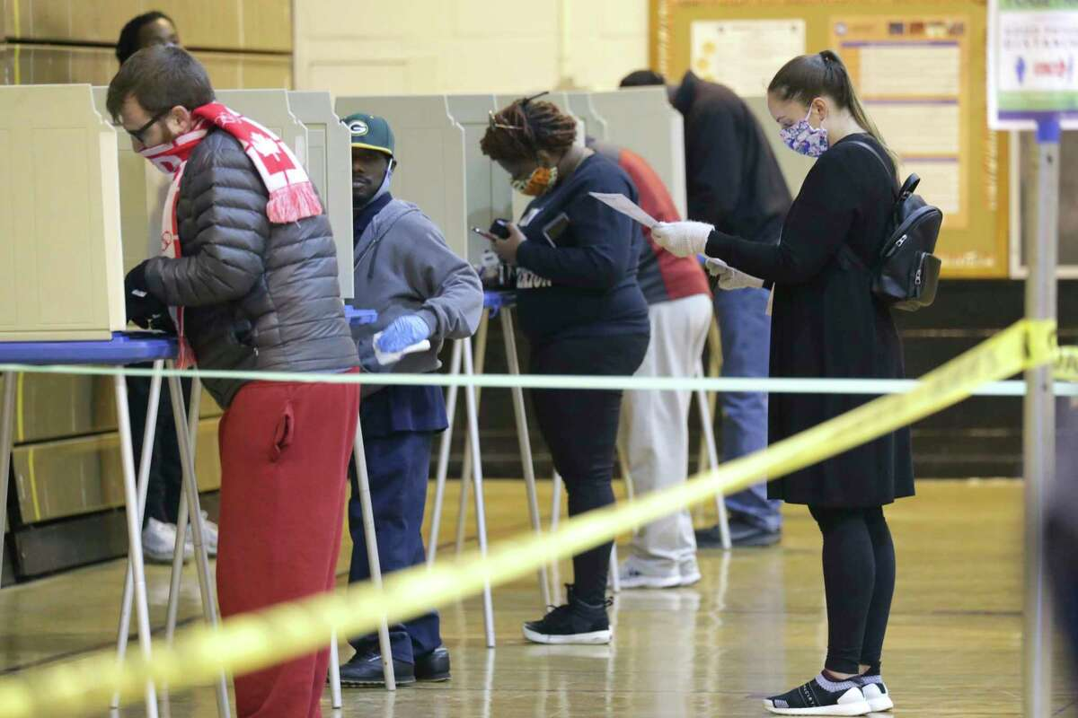 Voters lined up in Milwaukee, Wisconsin on April 7, 2020 amid the pandemic. A Rice University survey looked at Harris County voters' and poll workers' willingness to vote during a pandemic.