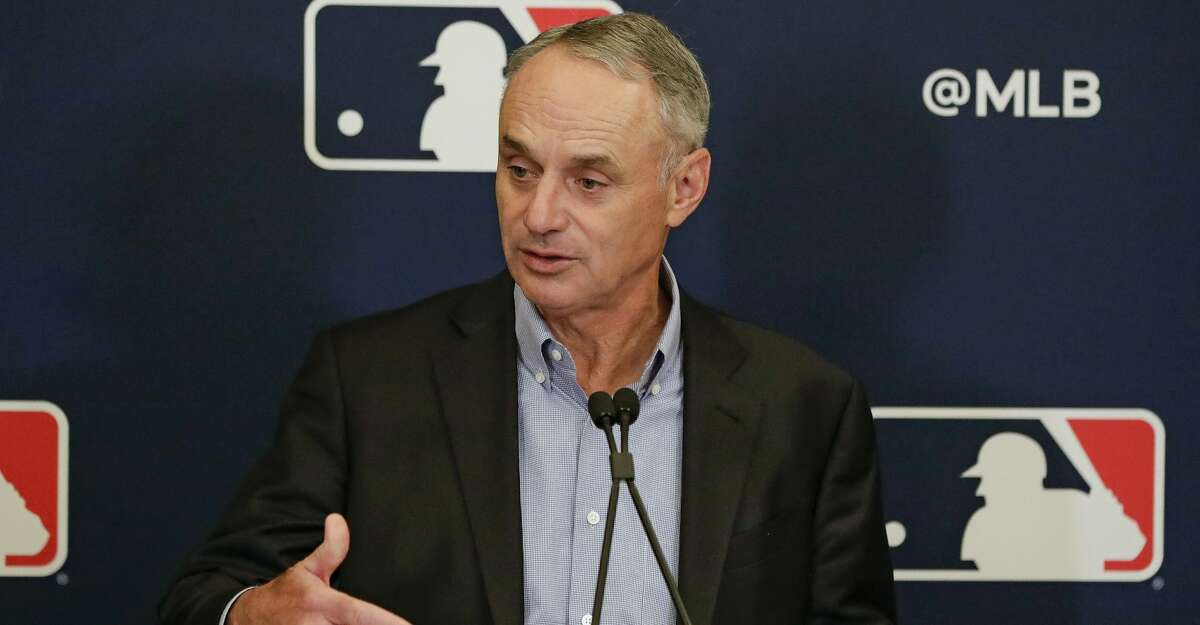 In this Feb. 6, 2020, file photo, Major League Baseball Commissioner Rob Manfred answers questions at a news conference during MLB baseball owners meetings in Orlando, Fla. (AP Photo/John Raoux, File)