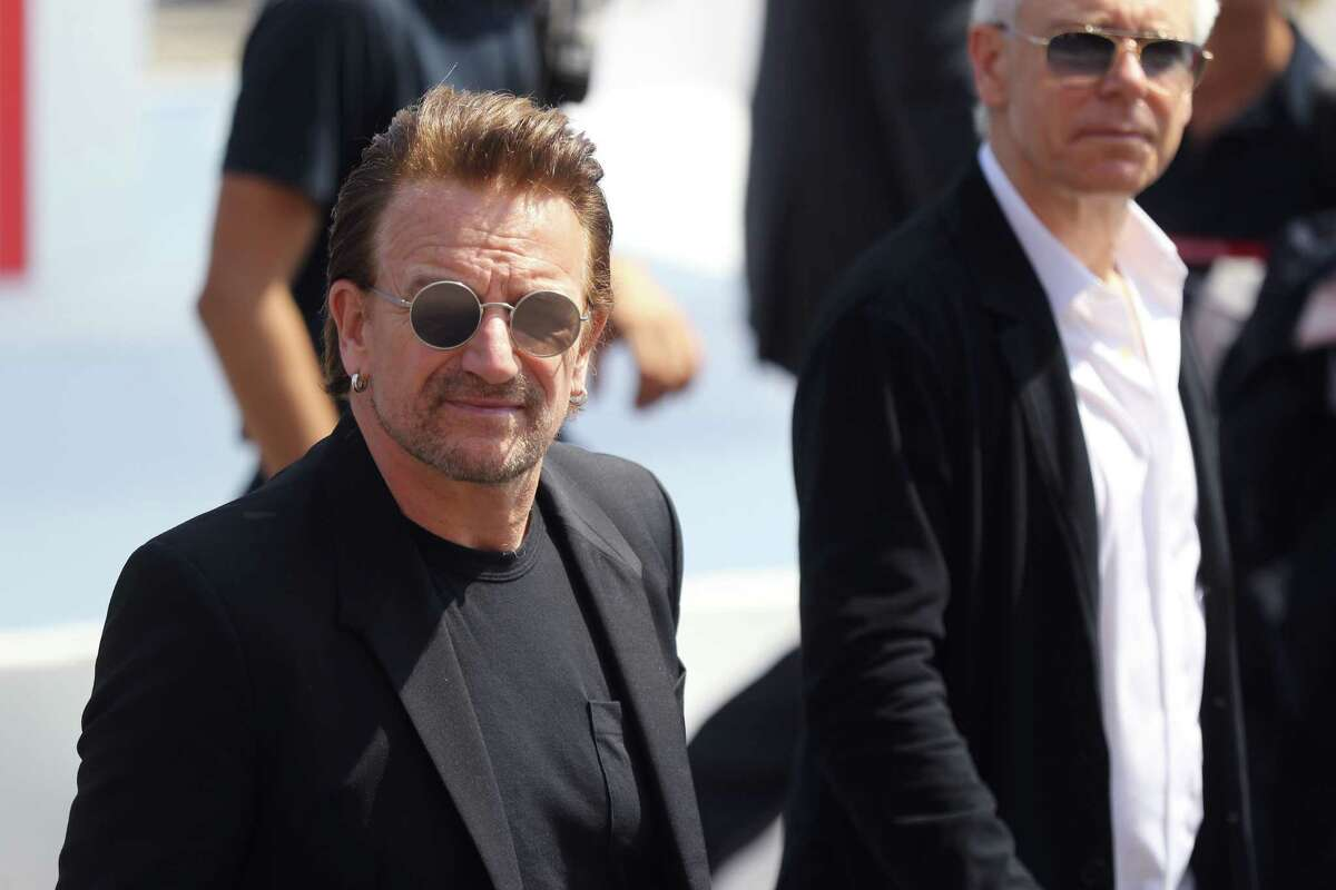 Irish singer Bono attends a commemorative ceremony marking the first anniversary of a jihadist truck attack which killed 86 people in Nice, southern France, on Bastille Day, July 14, 2017. Bastille Day celebrations were tinged with mourning, as the Mediterranean city of Nice payed tribute to the victims of an attack claimed by the Islamic State group one year ago, where a man drove a truck into a crowd, killing 86 people. / AFP PHOTO / Valery HACHEVALERY HACHE/AFP/Getty Images
