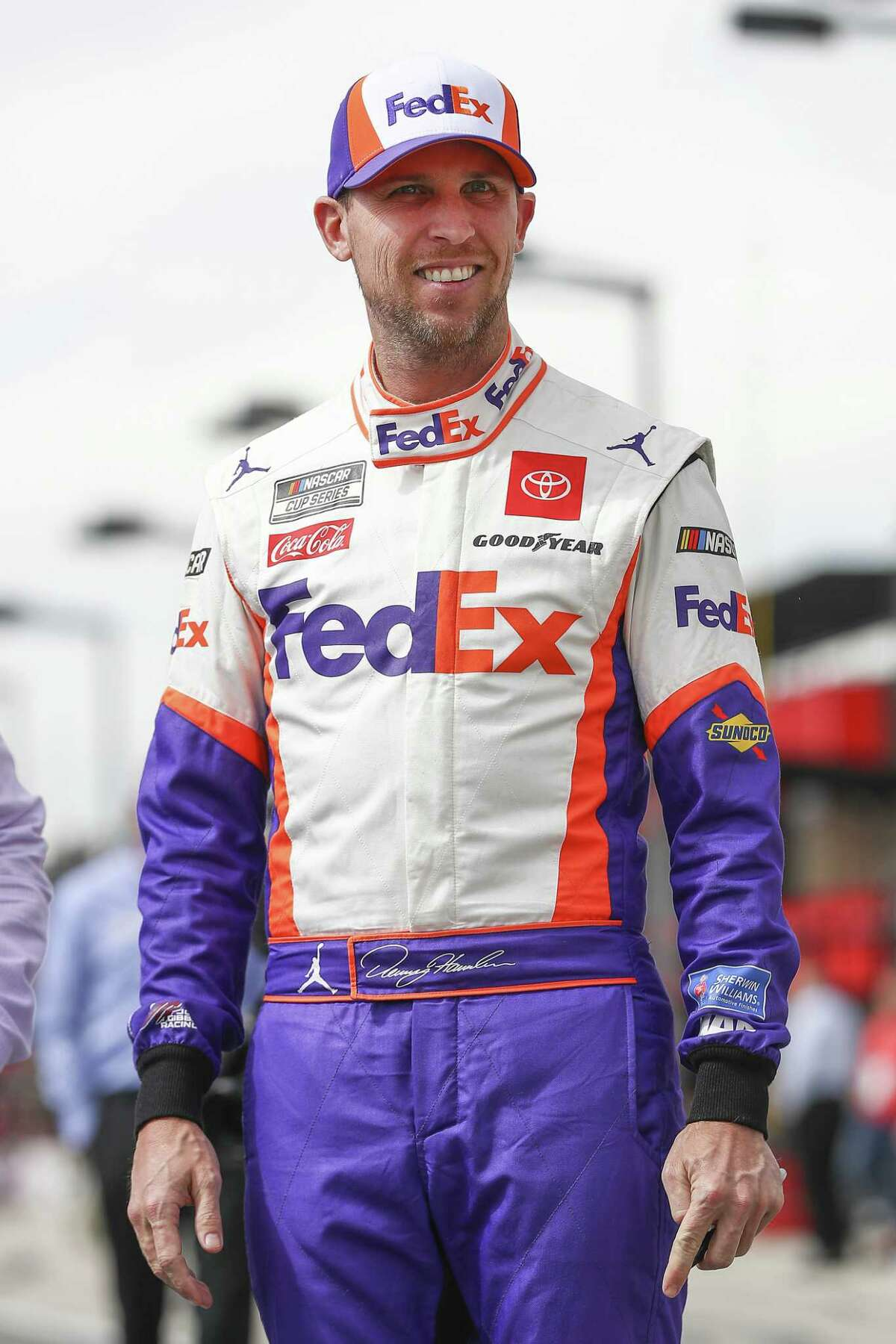 FONTANA, CALIFORNIA - FEBRUARY 29: Denny Hamlin, driver of the #11 FedEx Office Toyota, walks on the grid before qualifying at Auto Club Speedway on February 29, 2020 in Fontana, California. (Photo by Meg Oliphant/Getty Images)