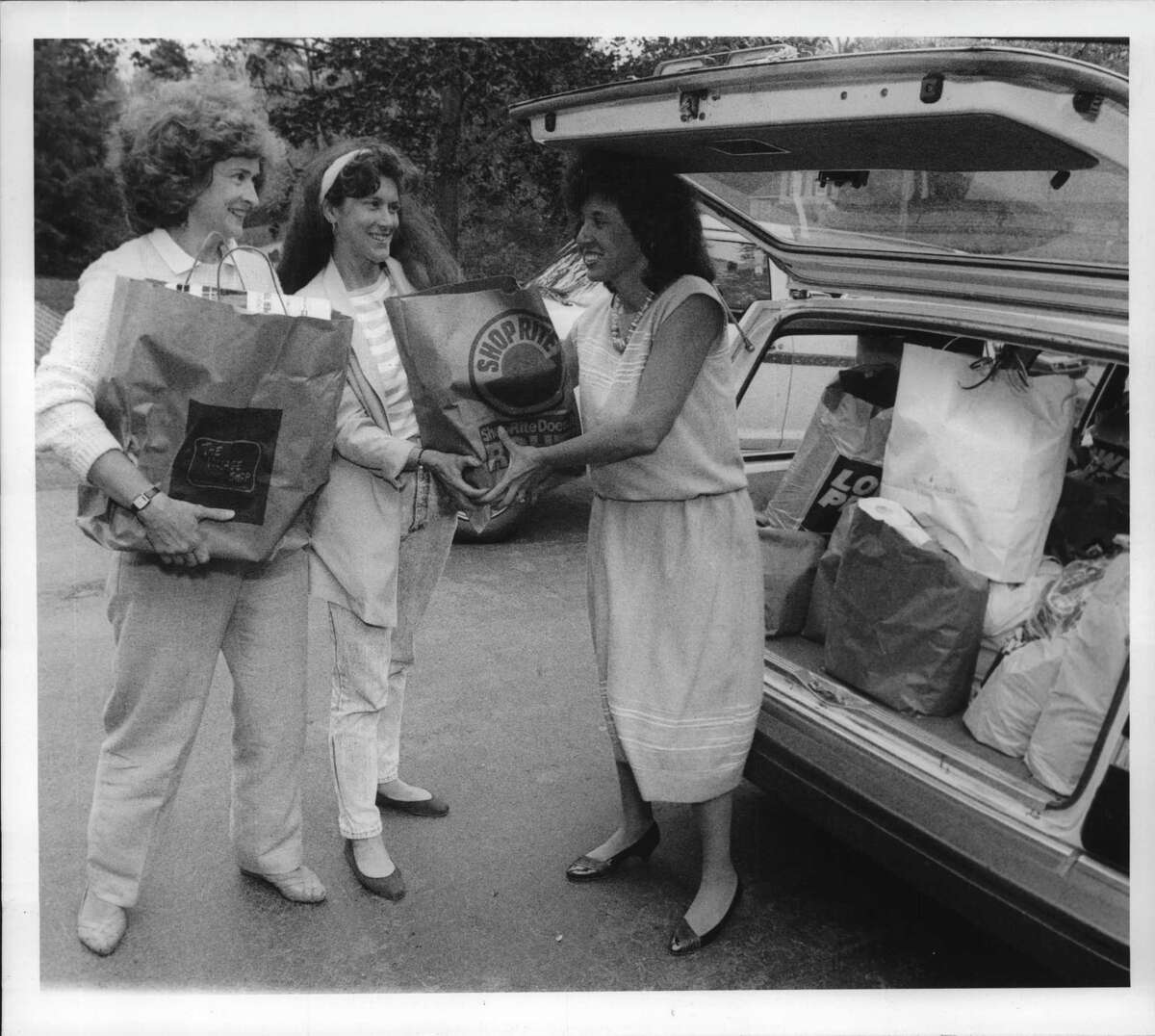 Glenmont, New York - Ellen Courtney, Program Chair from Junior League; Ellen Picotte; Lorraine D'Alea - they are the mothers day food collection programmers. May 10, 1990 (Skip Dickstein/Times Union Archive)