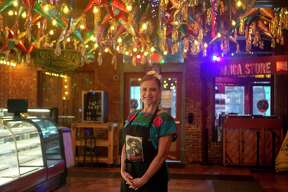 """Luz Arrendondo, 50, poses inside Mi Tierra Cafe y Panaderia in San Antonio, Texas on May 8, 2020. Arrendondo is known as """"La Mama de Bakery,"""" a title she earned after 17 years of working holidays, weekends and long hours at the restaurant she calls her American dream."""