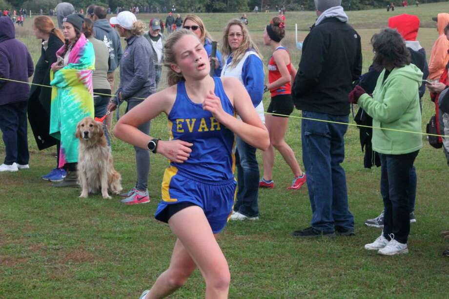 Evart's Sophia Scott gets close to the finish line of a cross country race last fall. (Pioneer file photo)