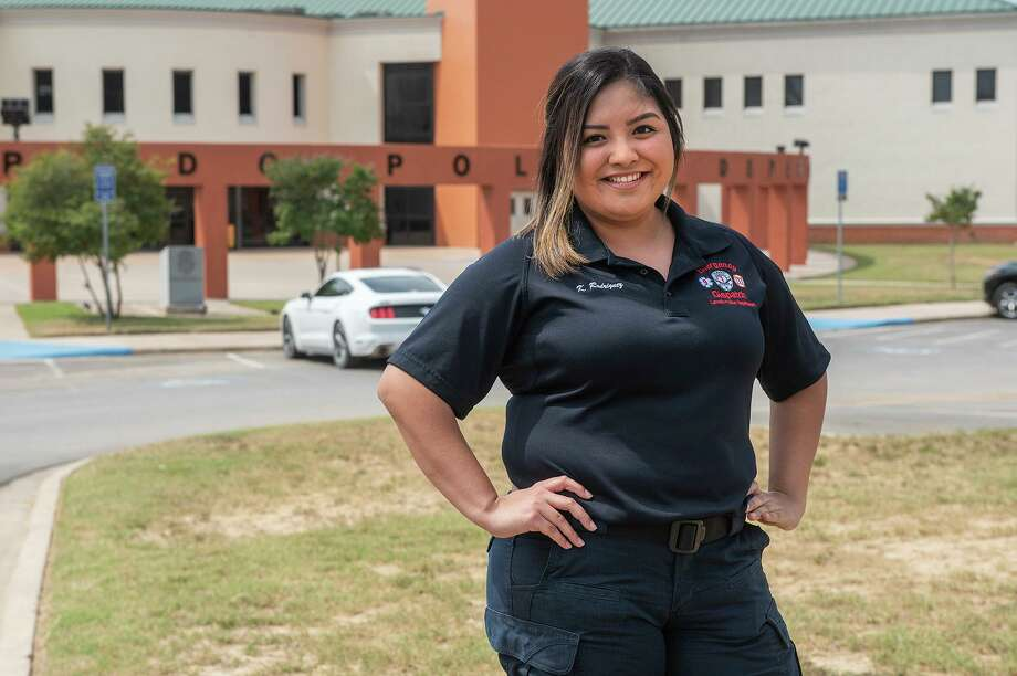 Dispatcher Karla Rodriguez poses for a photo out the Laredo Police Department, Saturday, May 9, 2020, for the Heroes Unmasked feature. Photo: Danny Zaragoza, Staff Photographer / Laredo Morning Times