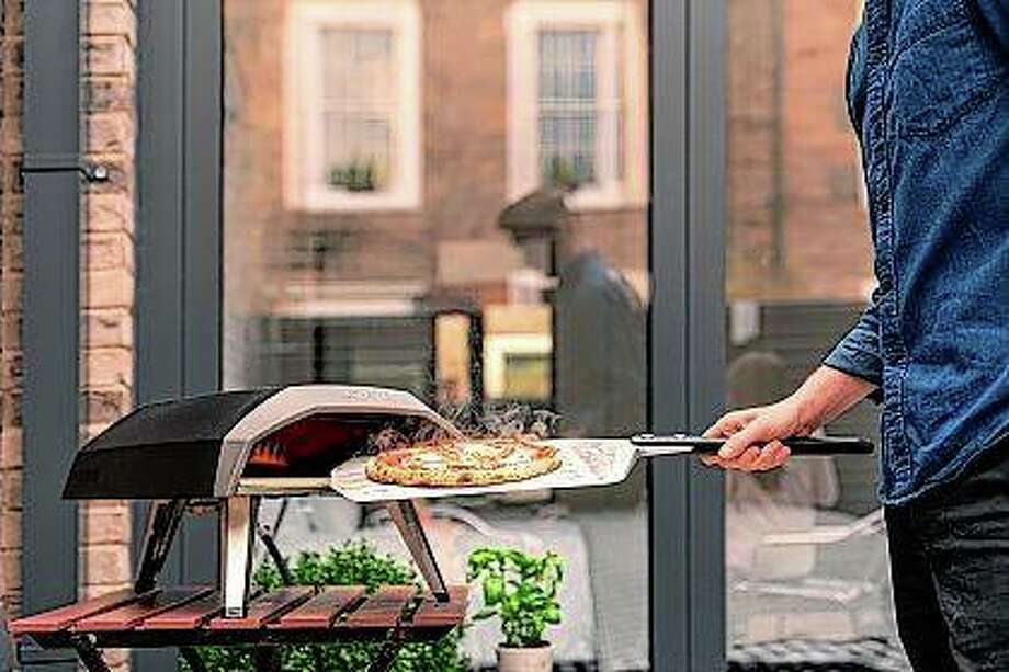 The handy Ooni Koda propane pizza grill is ready to go in 15 minutes and cooks pizza in about a minute. It also cooks roasted fish, steak or vegetables. Photo: Ooni Koda | Riverbend Home Via AP