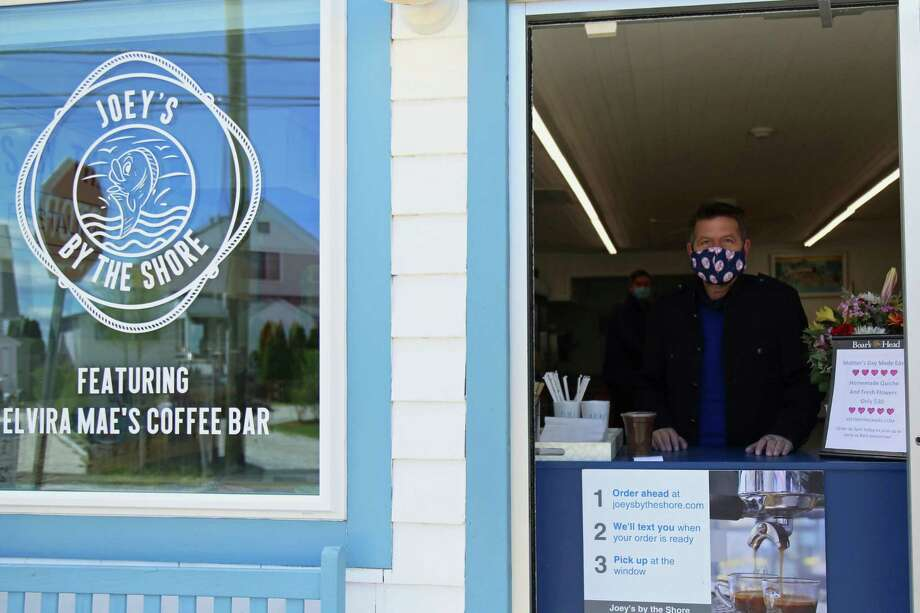 Joey Romeo attends to the takeout window at the new Joey's By The Shore Featuring Elvira Mae's Coffee Bar by Old Mill Beach on Saturday, May 9, 2020, in Westport, Conn. Photo: Jarret Liotta / Jarret Liotta / ©Jarret Liotta 2020