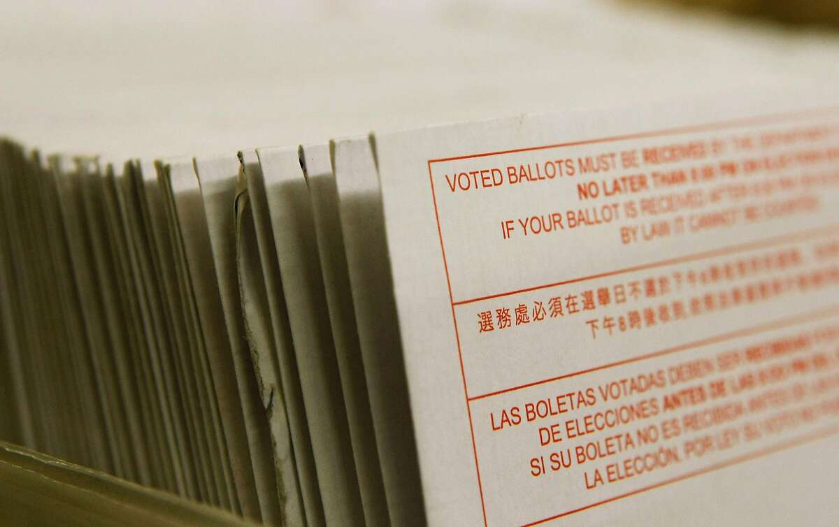 A stack of vote-by-mail ballots sit in a box after being sorted at the San Francisco Department of Elections on January 24, 2008. (Justin Sullivan/Getty Images/TNS)