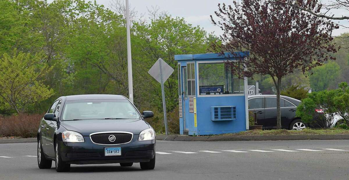 A car passes a parking attendant booth at Cove Island Park in Stamford Wednesday.