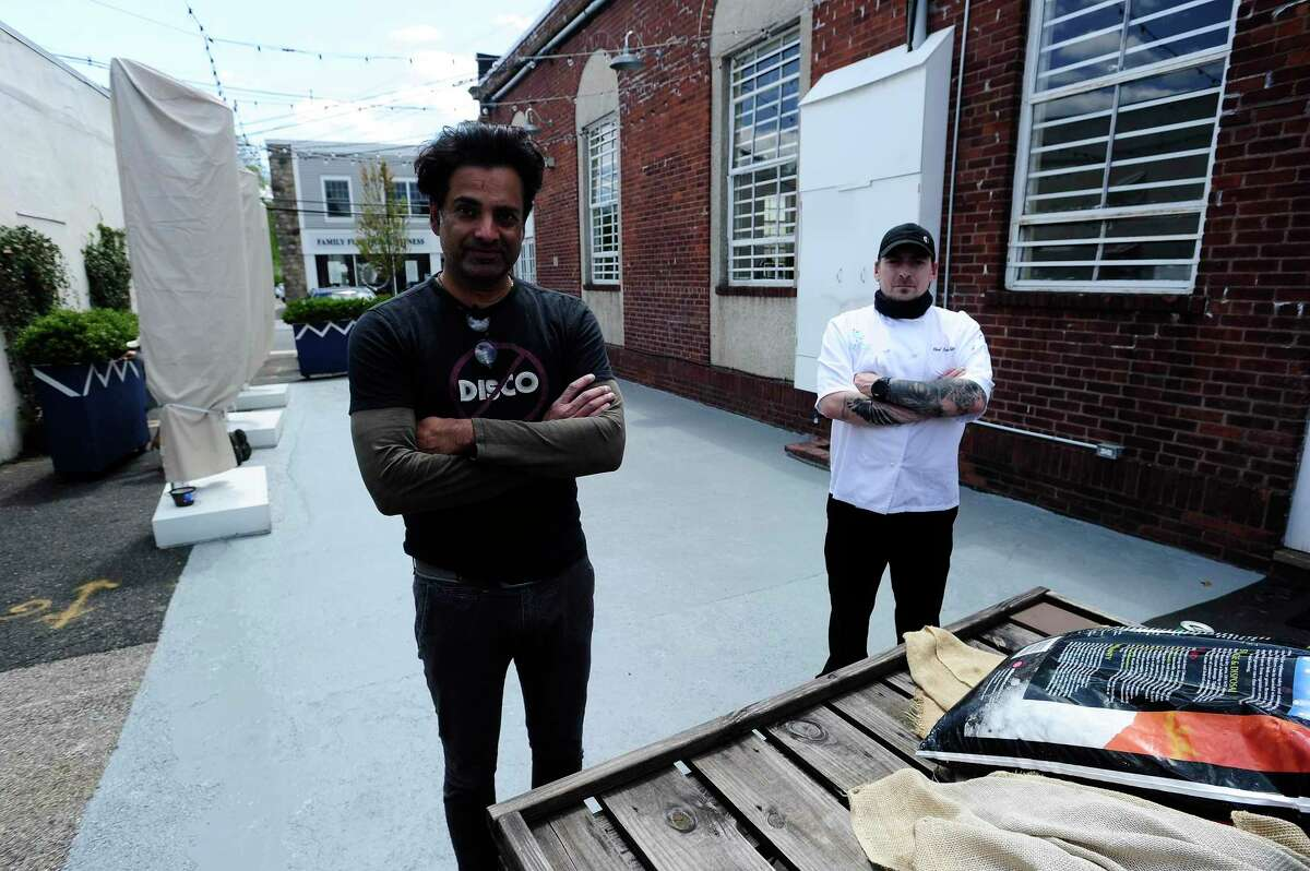 Chef Kris Grossmann and Anshu Vidyarthi, co-owner of Le Fat Poodle restaurant, are photographed on May 7, 2020 at the restaurant at 20 Arcadia Road in the Old Greenwich section of Greenwich, Conn. Le Fat Poodle plans to re-open sit-down dining on May 20, 2020, when restaurants in Connecticut are allowed to do outdoor seating.