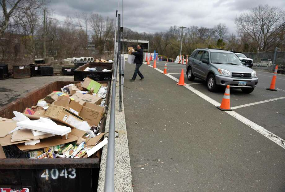 New social distancing practices are utilized at the Holly Hill transfer station in Greenwich, Conn. Tuesday, March 31, 2020. Photo: File / Tyler Sizemore / Hearst Connecticut Media / Greenwich Time