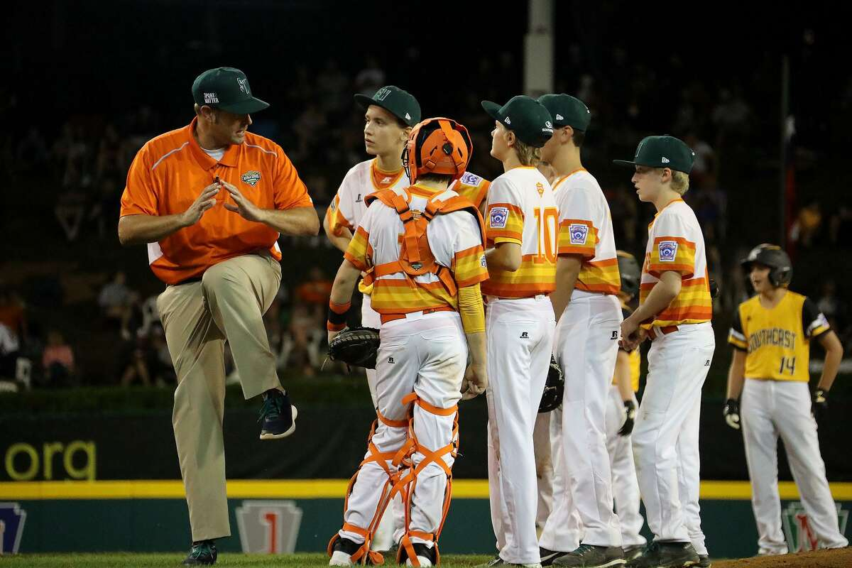 Post Oak Little League manager David Rook, talking his players during the 2018 Little League World Series tournament in South Williamsport, Pa., recognizes the need to cancel this year's event but is hopeful teams could play some this summer.