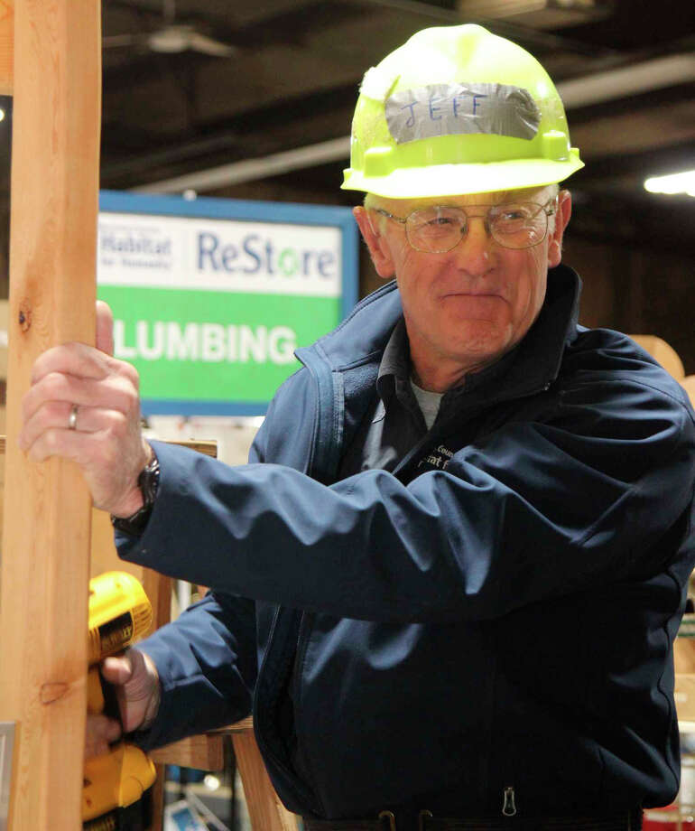 Jeff Greene volunteers for Habitat for Humanity in Big Rapids. He began volunteering in 2008 and has helped build 10 homes, as well as doing repairs on other homes. Photo: Submitted Photo / Forever Captured