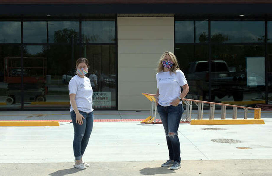 Heather Mohr, left, and Nichole Kolb pose Thursday in front of their new storefront in Trace on the Parkway, which is scheduled to open in July. Photo: Courtesy Of Nichole Kolb