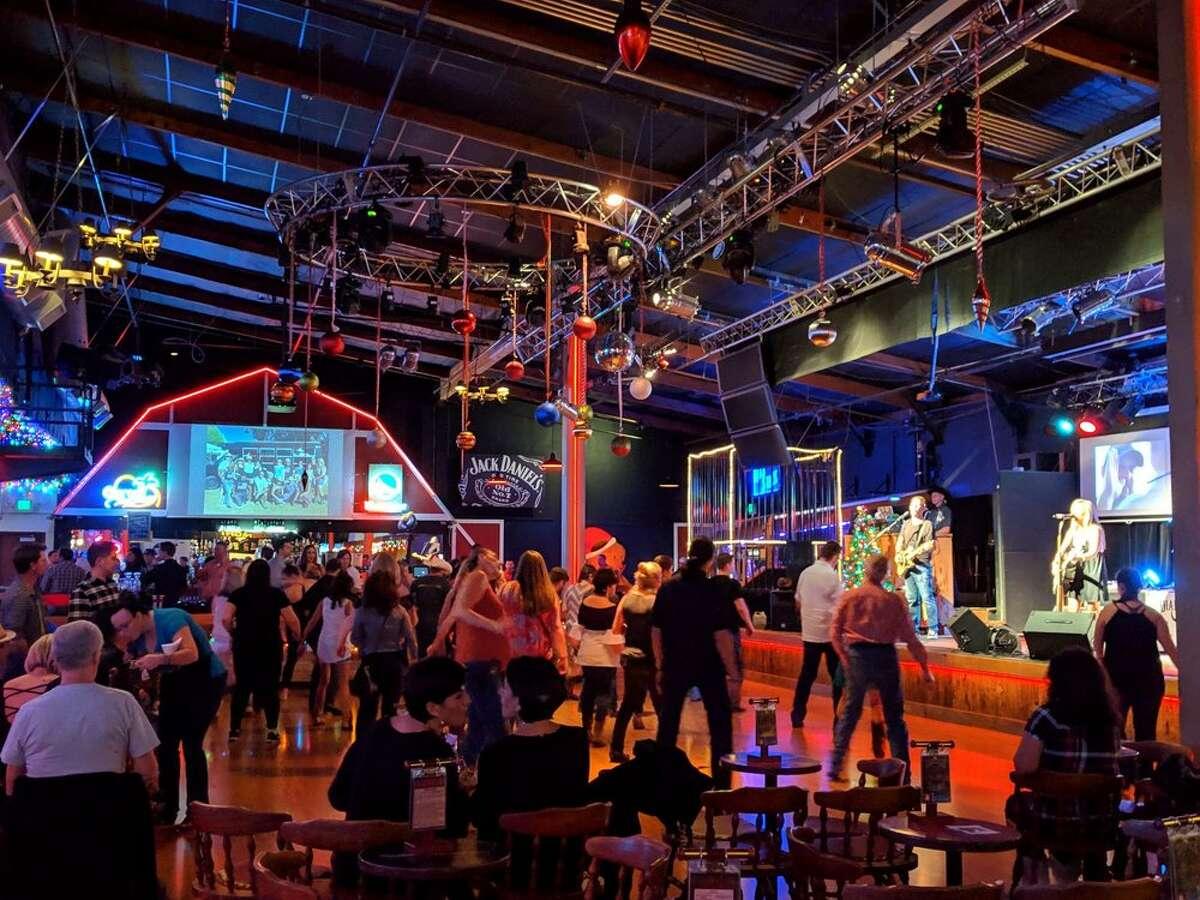 A group of line dancers shuffle at the Saddle Rack in Fremont, a country-style bar and nightclub that will close after 44 years in business.
