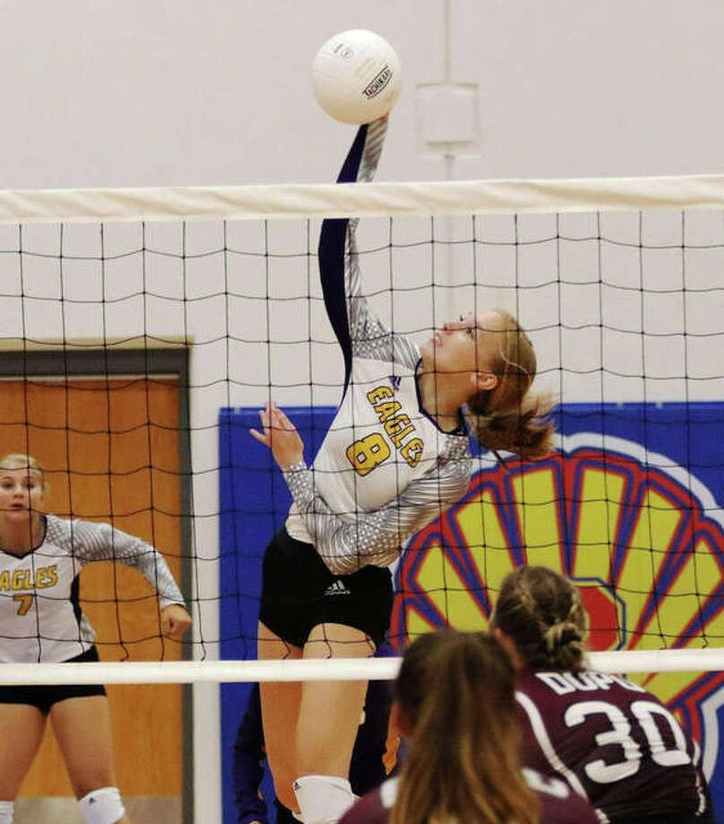 CM's Sydney Henke (8) attacks from the middle during an Eagles' win over Dupo last August in the Roxana Tourney at Roxana Junior High. A two-time All-MVC pick, Henke will play college volleyball in Indianapolis with NAIA defending national champion Marian. Photo: Greg Shashack / The Telegraph