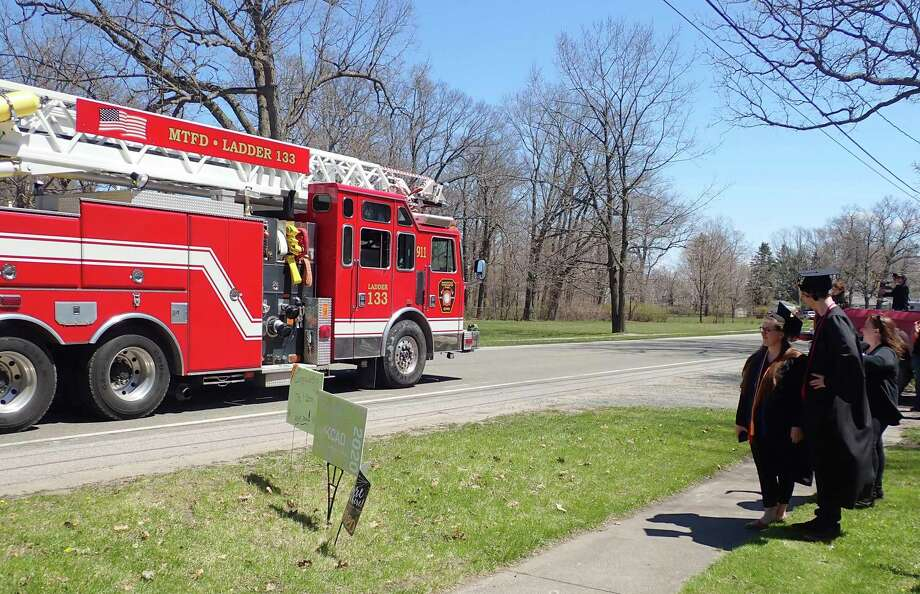 First responders, including firefighters from Manistee Township Fire Department joined in a parade in recognition of two Kendall College of Art and Design graduates. (Courtesy Photo)