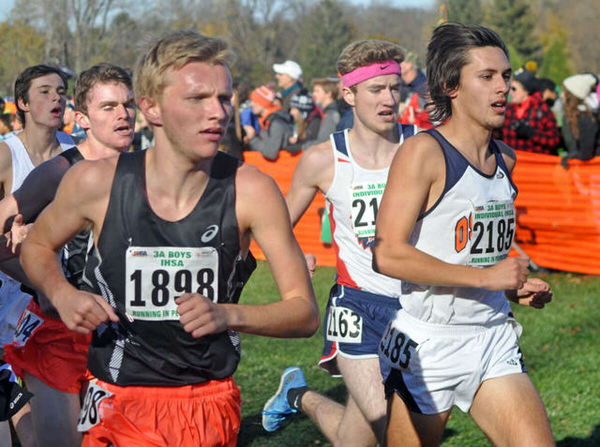 Edwardsville senior Brydon Groves-Scott, left, competes in the Class 3A state boys' meet in East Peoria.