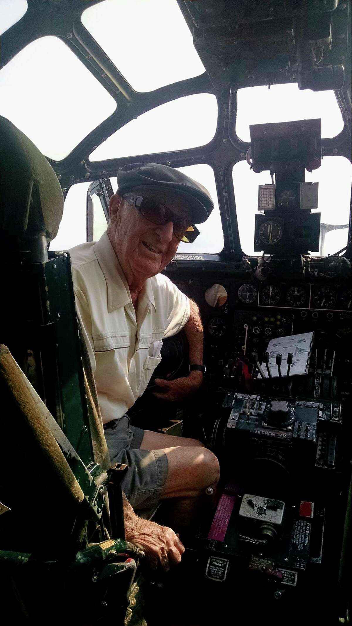 WWII veteran Frank Lopetrone sits in the the cockpit of a B-24 Liberator in 2016. He turned 96 on Saturday. (Courtesy Photo)