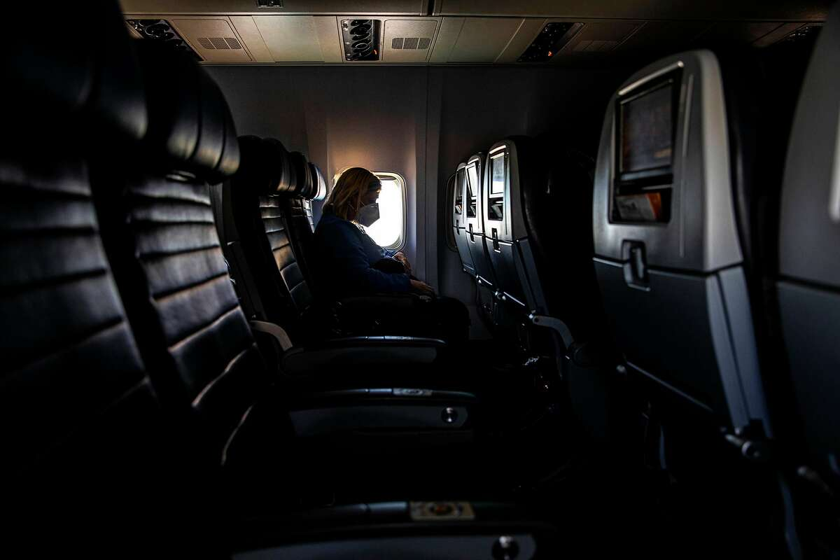 FILE -- Aboard a nearly empty United Airlines flight from Chicago to New York, April 18, 2020, amid the coronavirus pandemic. With much of the world closed for business, and no widely available vaccine in sight, it may be months, if not years, before airlines operate as many flights as they did before the crisis. (Hiroko Masuike/The New York Times)