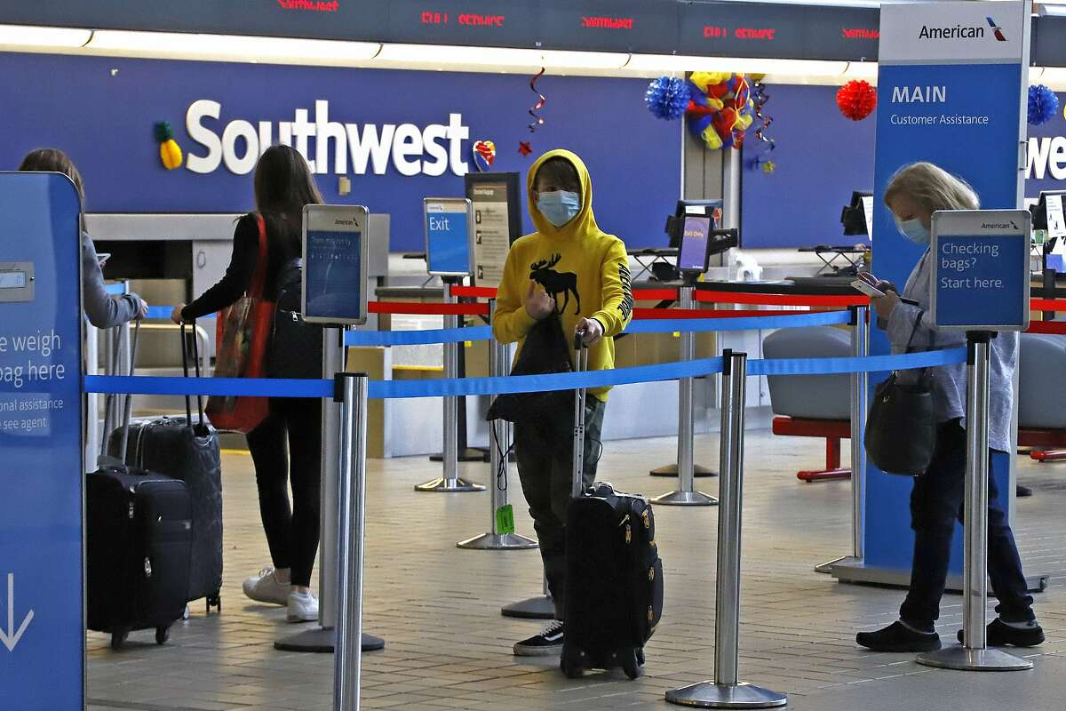 Travelers check in at the American Airline ticket counter at Greater Pittsburgh International Airport on Thursday, May 7, 2020. (AP Photo/Gene J. Puskar)