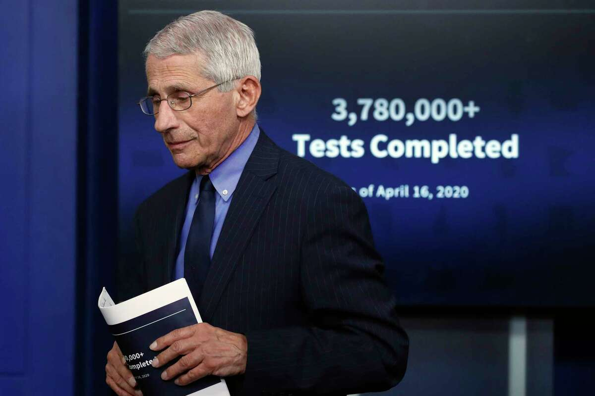 FILE - In this Friday, April 17, 2020, file photo, Dr. Anthony Fauci, director of the National Institute of Allergy and Infectious Diseases, walks from the podium after speaking about the new coronavirus in the James Brady Press Briefing Room of the White House, in Washington. Three members of the White House coronavirus task force, including Fauci, have placed themselves in quarantine after contact with someone who tested positive for COVID-19, another stark reminder that not even one of the nationa€™s most secure buildings is immune from the virus. (AP Photo/Alex Brandon, File)