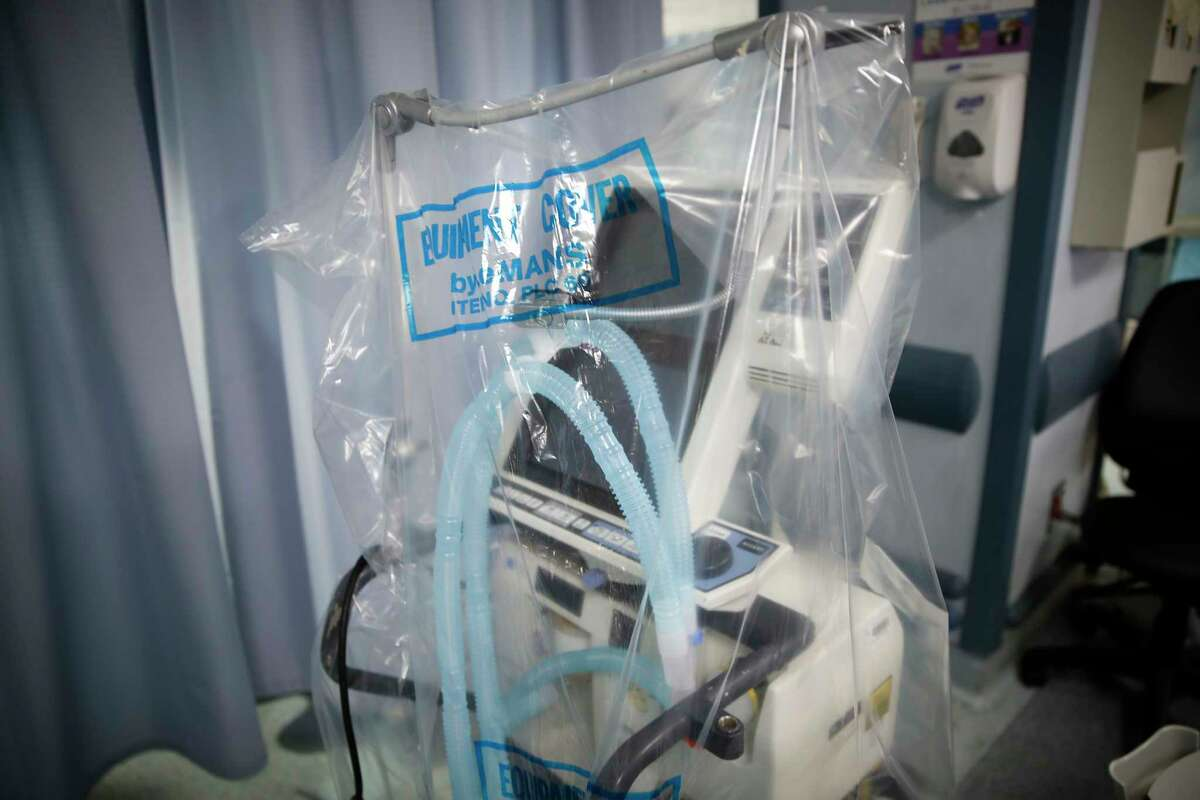 FILE - In this April 20, 2020, file photo a ventilator waits to be used for a COVID-19 patient going into cardiac arrest at St. Joseph's Hospital in Yonkers, N.Y. An analysis of federal contracting data by The Associated Press shows the Department of Health and Human Services is now on track to exceed 100,000 new ventilators by around July 13, about a week later than the 100-day deadline Trump first gave on March 27. (AP Photo/John Minchillo, File)