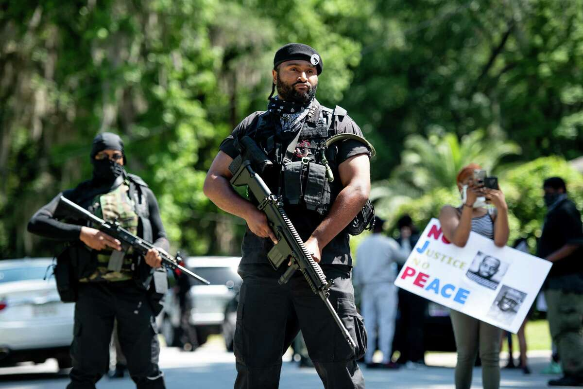 """BRUNSWICK, GA - MAY 09: Members of the Black Panther Party, """"I Fight For My People"""", and """"My Vote is Hip Hop"""" demonstrate in the Satilla Shores neighborhood on May 9, 2020 where Ahmaud Arbery was shot and killed in Brunswick, Georgia. Arbery, a black man, was killed by two white men, a former police officer and his son, while jogging in the neighborhood on February 23. (Photo by Sean Rayford/Getty Images) ***BESTPIX***"""