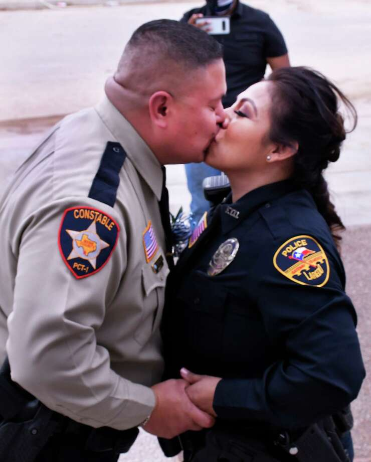 As a result of the COVID-19 virus, Laredo police officer Mayra Perez and Webb County Precinct 1 Deputy Constable Mario Reyes exchanged wedding vows in a virtual ceremony, Friday, May 8, as Justice of the Peace Precinct 2 Place 2, Danny Dominguez conducted the ceremony from his office via a cellphone. Photo: Cuate Santos /Laredo Morning Times / Laredo Morning Times