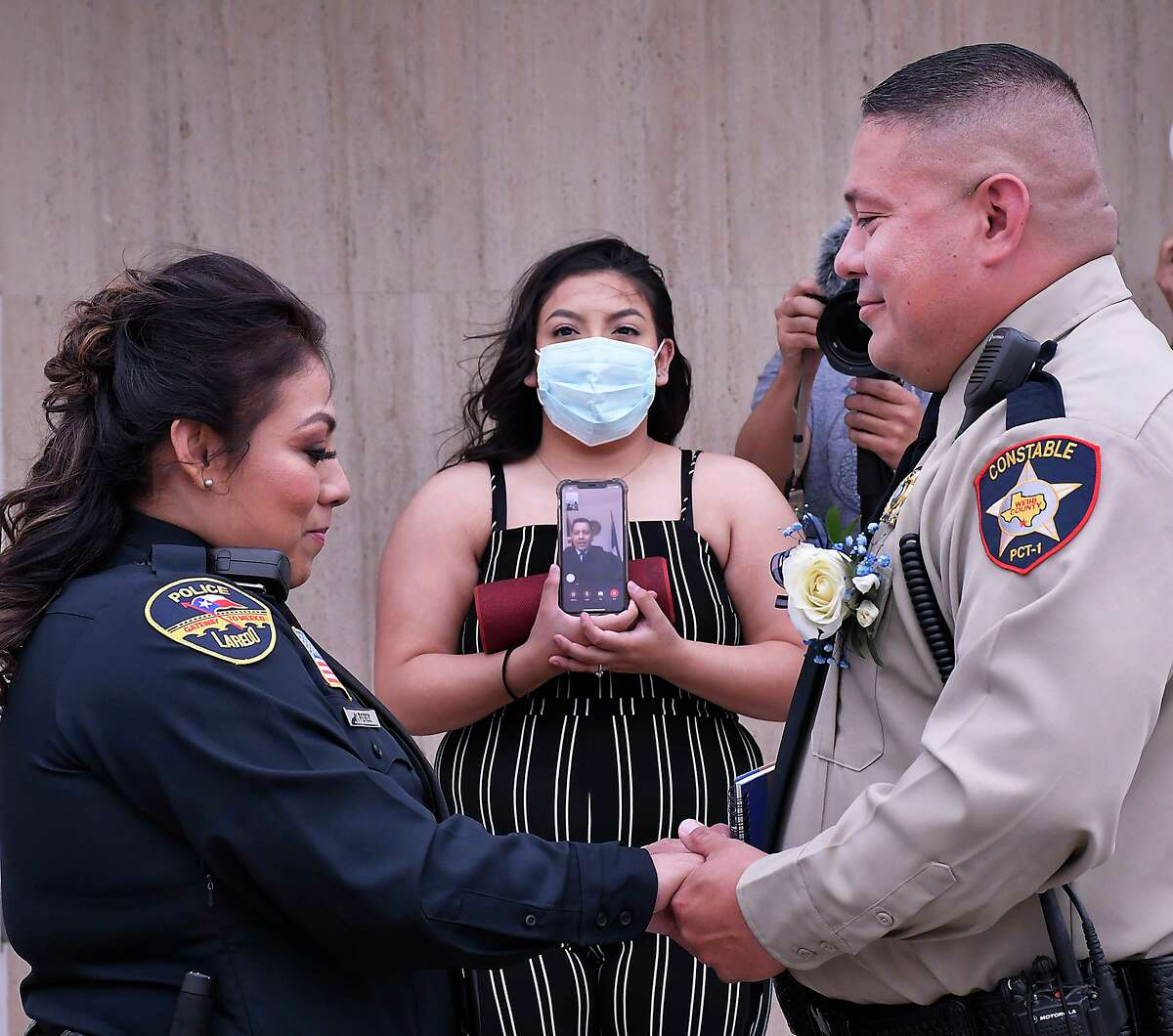 As a result of the COVID-19 virus, Laredo police officer Mayra Perez and Webb County Precinct 1 Deputy Constable Mario Reyes exchanged wedding vows in a virtual ceremony, Friday, May 8, as Justice of the Peace Precinct 2 Place 2, Danny Dominguez conducted the ceremony from his office via a cellphone.